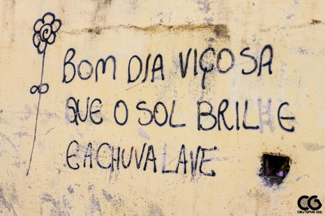 "I think it says: ""Good morning Viçosa, May the sun shine and the rain wash (down)"""