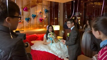 At hotel Sheraton for some local customs, where bridegroom and groomsmen try to please bride in various activities