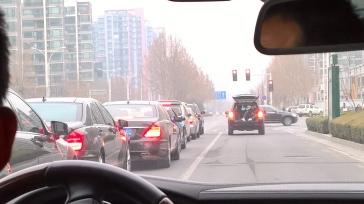 Convoy of Porche, Mercedeces and BWMs, plus camera car.